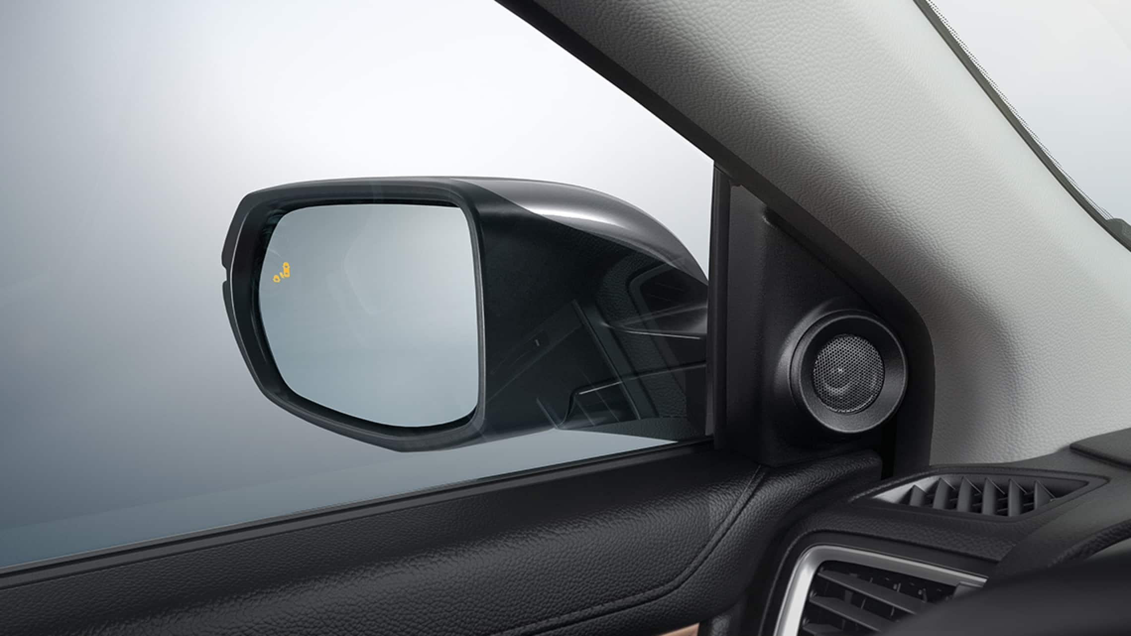 2019 Honda CR-V Touring with Blind Spot Information system warning icon on side mirror.