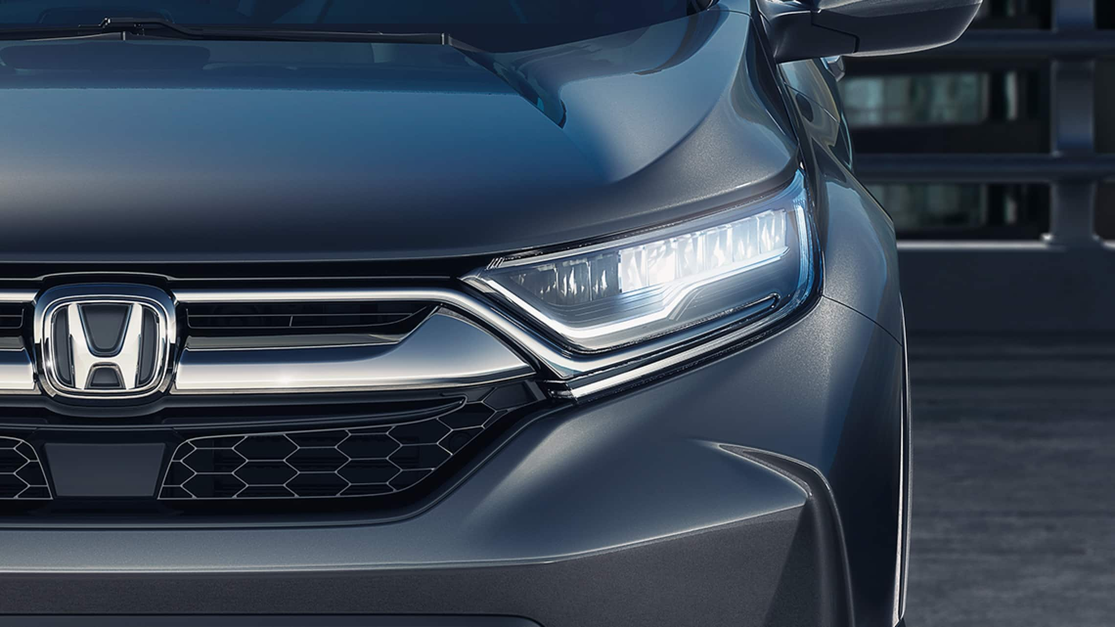 Front close up view of 2019 Honda CR-V Touring with full LED headlights with auto-on/off.
