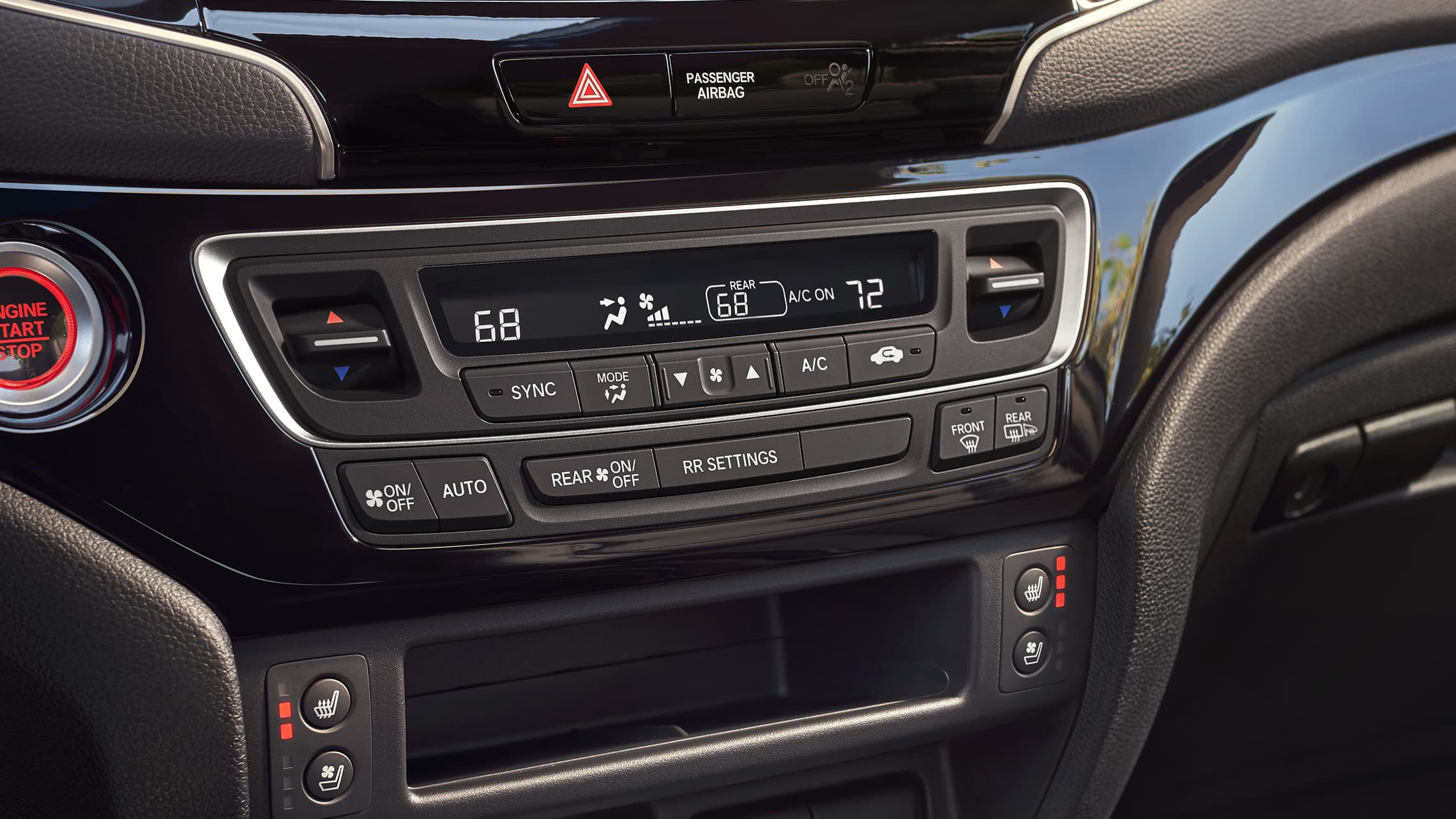 Tri-zone climate control detail on the 2019 Honda Passport Elite with Black Leather interior.