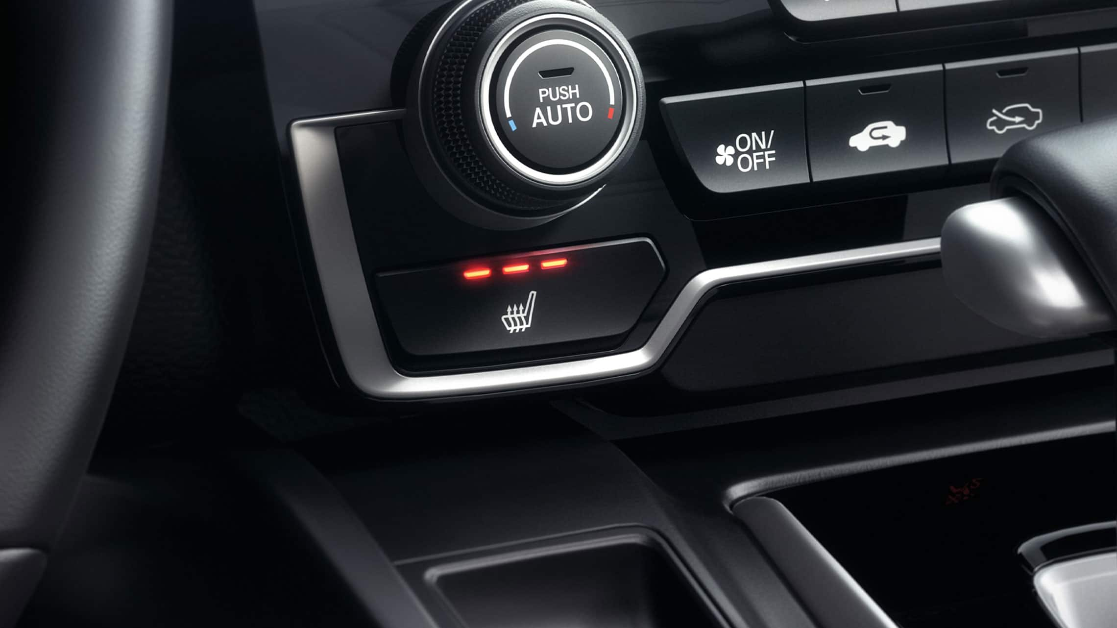 Heated front seat controls detail in the 2020 Honda CR-V interior.