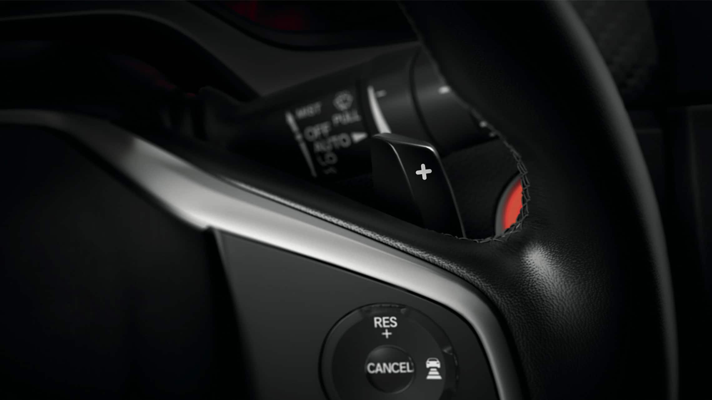 Steering wheel-mounted paddle shifter detail on 2020 Honda Civic Sport Touring Hatchback.