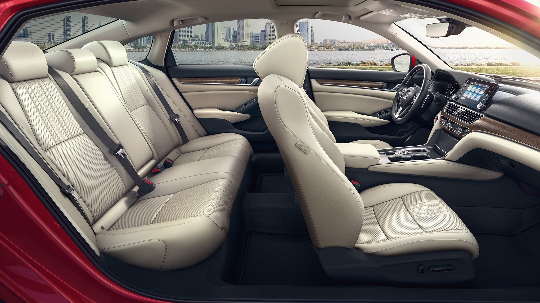 Passenger-side view of interior seats in the 2021 Honda Accord Touring 2.0T in Radiant Red Metallic with Ivory Leather.